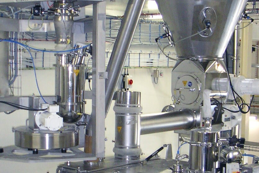 Coperion K-Tron feeders over mixer in infant formula application